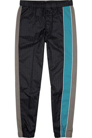 Valentino Navy logo panelled shell track pants