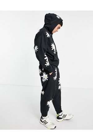 ASOS Men Sports Pants - Oversized sweatpants in with all over daisy prints - part of a set