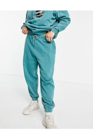 ASOS Two-piece oversized sweatpants in acid wash