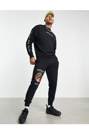 ASOS Men Tracksuits - Lightweight tracksuit in black with multi placement tech prints-Blues