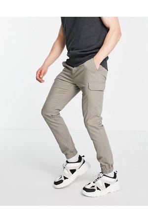 ASOS DESIGN Skinny cargo cuffed pants in dark -Neutral
