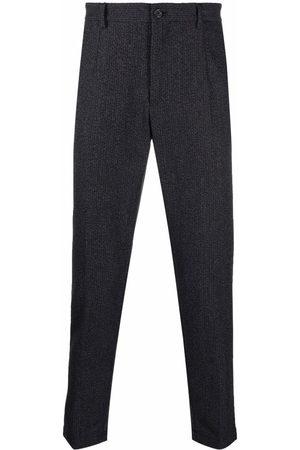 Dolce & Gabbana Pinstripe-pattern pressed-crease trousers