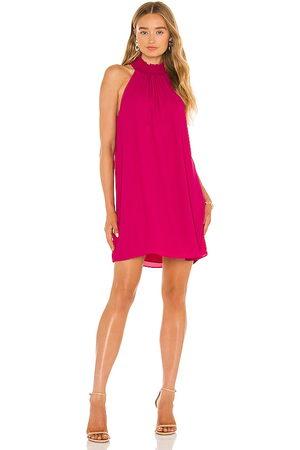 krisa Smocked Turtleneck Shift Dress in Fuchsia.