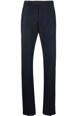 Versace Monogram pattern tailored trousers