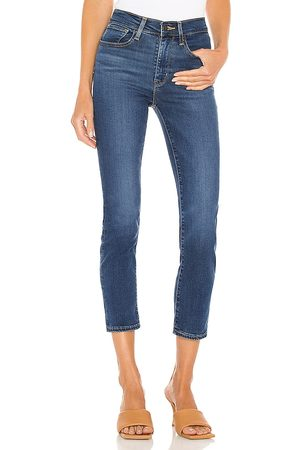 LEVI'S 724 High Rise Straight Leg Jean in Blue.