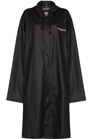 Vetements Women Trench Coats - Oversized slogan print raincoat