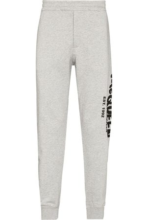 Alexander McQueen Graffiti-print track pants - Grey