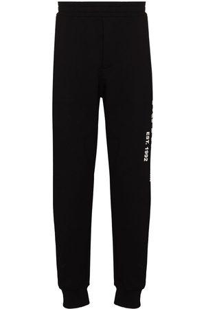 Alexander McQueen Logo graffiti print track pants