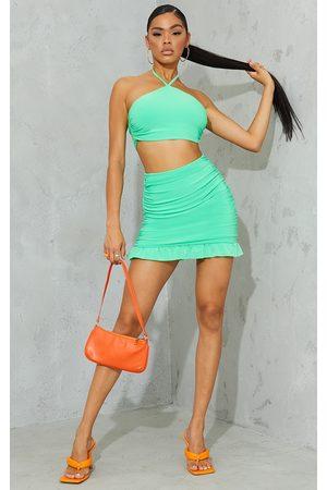 PrettyLittleThing Bright Slinky Ruched Side Frill Panel Hem Mini Skirt