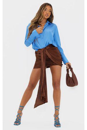 PrettyLittleThing Chocolate Satin Drape Ruched Side Mini Skirt