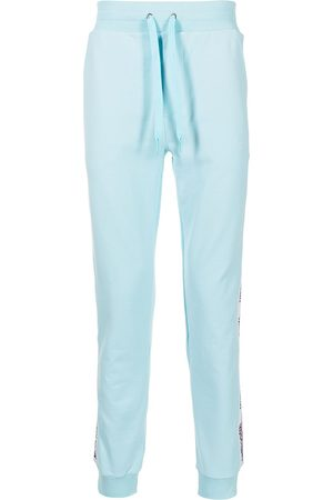 Moschino Men Sports Pants - Logo tracksuit bottoms