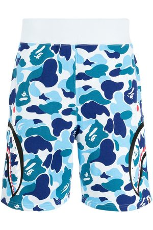 A BATHING APE® Camouflage-print logo track shorts