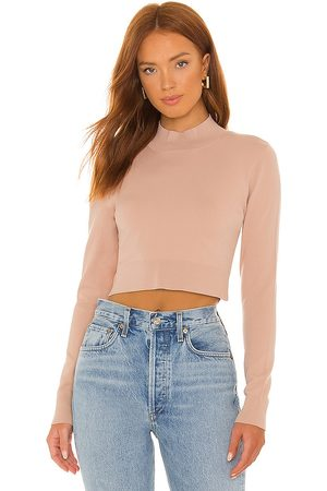 525 Cropped Turtleneck Sweater in Pink.