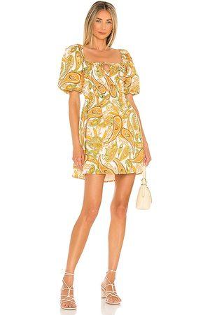 FAITHFULL THE BRAND Nikoleta Mini Dress in Mustard.