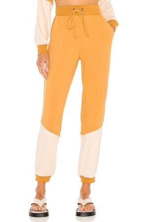 KENDALL + KYLIE Colorblock Jogger in Mustard.