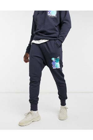 ASOS Tapered sweatpants in navy with flower print - part of a set