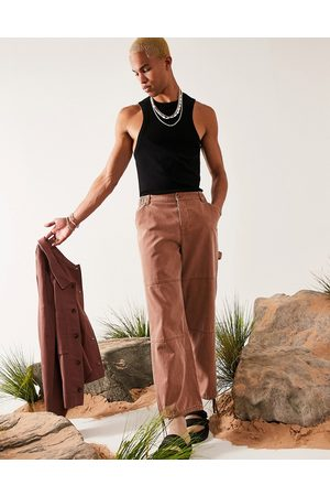 ASOS DESIGN Wide fit pants with carpenter pockets in texture