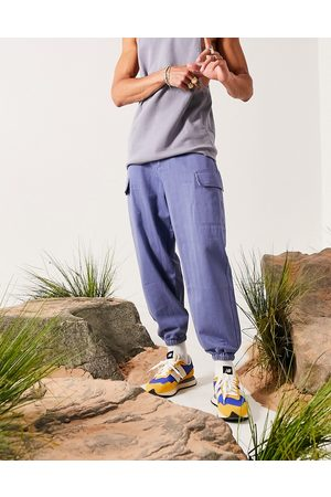 ASOS Oversized tapered pants in blue-Blues