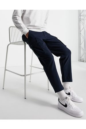 Selected Homme Loose fit tapered cargo pants in navy with organic cotton