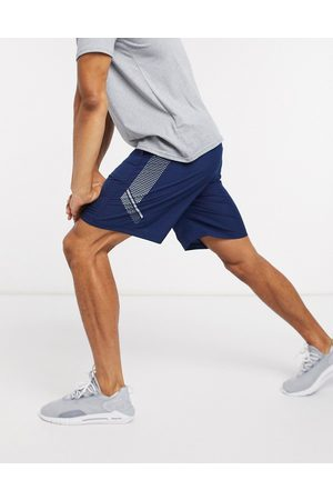 Under Armour Training woven graphic logo shorts in navy