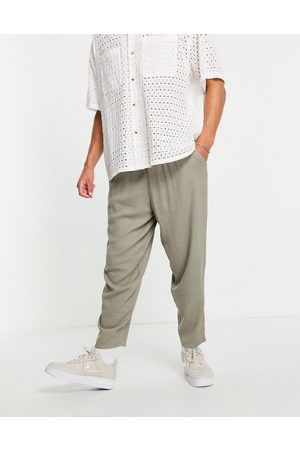 ASOS Men Chinos - Oversized tapered lightweight pants with elasticized waist in khaki