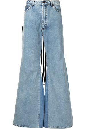 Natasha Zinko Women Flares - Fringed flared jeans