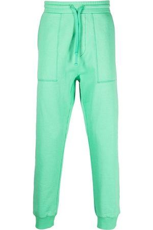 Nanushka High-waisted tapered trousers