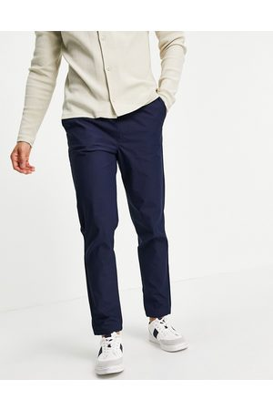 SELECTED Organic cotton blend pants with elastic cuff in navy