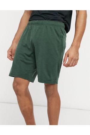 Nike Nike Yoga Hyperdry shorts in khaki