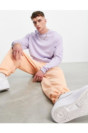ASOS Men Hoodies - Tracksuit with oversized hoodie and super oversized sweatpants in purple/orange-Multi