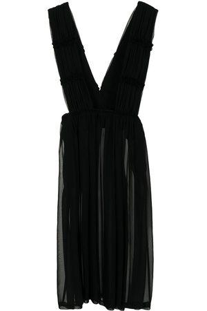 Comme des Garçons Women Asymmetrical Skirts - Sheer jumper skirt - 1