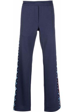 VALENTINO Men Sweatpants - Logo-trim track pants