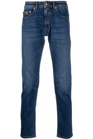 VERSACE Men Straight - Logo-embroidered straight-leg jeans