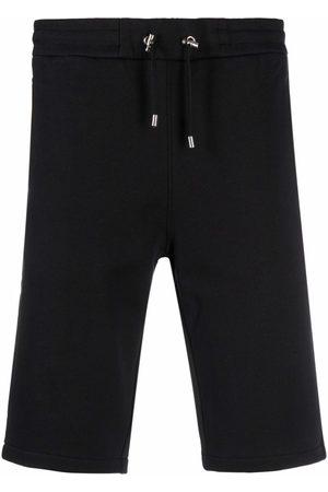 Balmain Men Bermudas - Bermuda B-print shorts