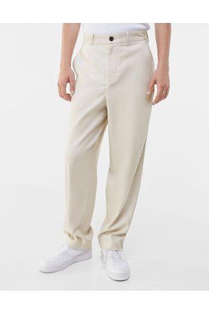Bershka Wide fit smart pants in sand-Neutral