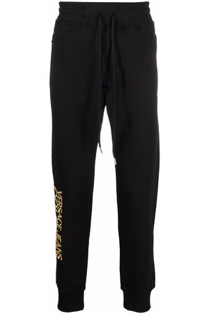 VERSACE Men Straight Leg Pants - Logo-embroidered jersey trousers