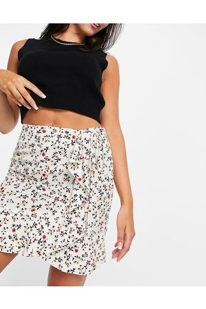 Aligne Mini skirt with ruffle detail and side tie in floral print-Multi