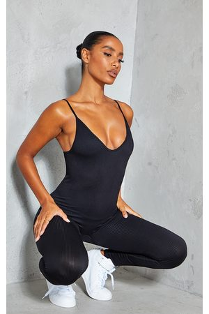 PRETTYLITTLETHING Structured Contour Rib Strappy Plunge Jumpsuit
