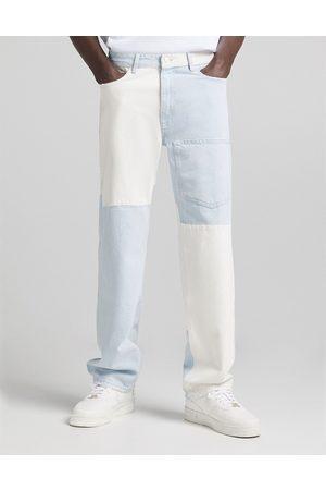 Bershka 90s fit spliced jeans in multi-Blues
