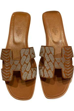 Hermès Oran leather mules