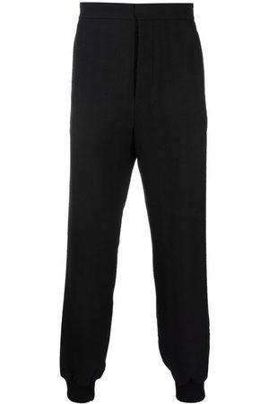 ANN DEMEULEMEESTER Men Sweatpants - Jack wool track pants
