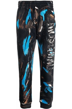 Moschino Painted logo trousers