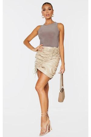PRETTYLITTLETHING Stone Faux Leather Front Ruched Mini Skirt