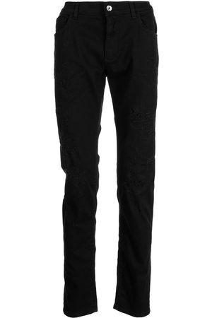 Dolce & Gabbana Logo plaque distressed skinny jeans