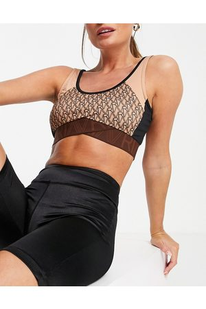 River Island Active monogram sports bra in - part of a set