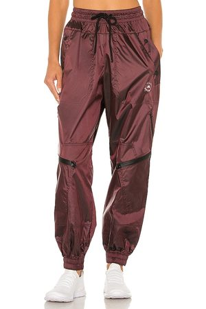adidas ASMC Woven Track Pant in Burgundy.