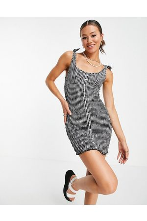 Emory Park Button through mini dress with tie straps and shirring in gingham