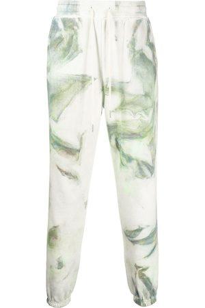 JOHN ELLIOTT Tie-dye cotton track pants - Multicolour
