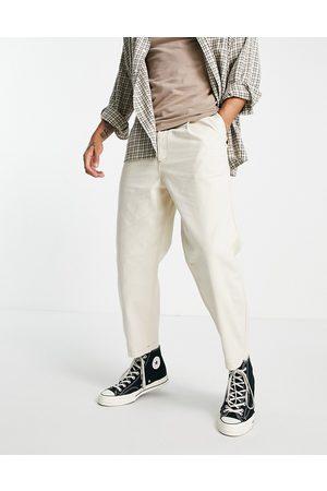 Topman Pleat front taper jeans in ecru