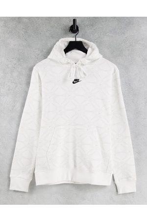 Nike Branded AOP Pack logo hoodie in